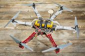 FORT COLLINS, CO, USA, November 18,  2014:  Radio controlled DJI  F550 Flame Wheel  hexacopter drone with NAZA V2 system on a wooden deck. This drone assembled from a kit is ready to fly.