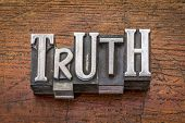 truth word in mixed vintage metal type printing blocks over grunge wood