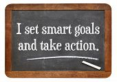 I set smart goals and take action - positive affirmation words on a vintage slate blackboard