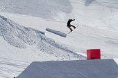Snowboarder jumps in Snow Park,  mountain ski resort.