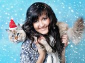 Young Woman With Santa Cat