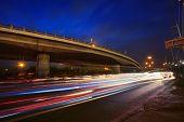 Traffic Lighting On Rush Hour Road And Express Ways Bridge Against Beautiful Dusky Sky