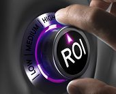 stock photo of maxim  - Return on Investment ROI Concept two fingers turning button in the highest position - JPG