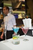 Three color cocktails preparing on the bar counter in a bar