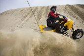 Sand Spray In The Dunes On Atv