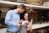 Lovely couple enjoying red wine at the nightclub
