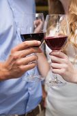 Close up of lovely couple enjoying red wine at the nightclub
