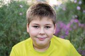 Portrait of a boy teen outdoors