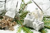 Silver Christmas Gifts With Silver Ribbon And Needles Fir With R