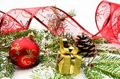 Golden Christmas Gifts,baubles With Red Ribbon And Needles Fir O