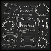 set of hand-drawn design elements on chalkboard