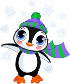 Illustration of cute winter penguin with hat and scarf  pointing. Raster version.