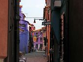 Burano Street with houses family colorful