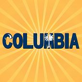 Columbia flag text with sunburst illustration