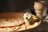 foto of covenant  - Chalice with red wine and pita bread in a basket - JPG