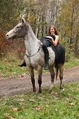 Amazing Girl With Long Hair Riding A Horse