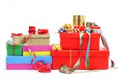 a pile of different boxes, ribbon and ribbon bows of different colors to prepare gifts, on a white background