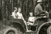 POLAND, CIRCA SIXTIES: Vintage photo of parents with little son traveling by horse-drawn carriage