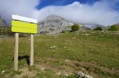 green signboard in the Pyrenees mountains, Spain