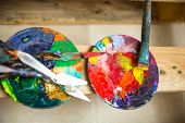 Paints and brushes in atelier