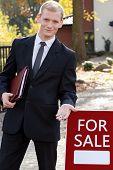 Handsome Real Estate Broker