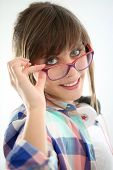 Modern young girl with eyeglasses on