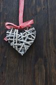 Shabby chic heart christmas decoration on a wooden background