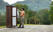 wooden wardrobe with a man on a mountain road