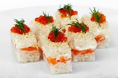 Maki Sushi With Salmon, Red And Black Caviar. Selective Focus