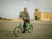 Graceful girl riding a bike