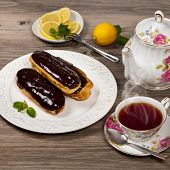 foto of eclairs  - Delicious homemade eclairs with a chocolate ganache - JPG