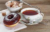 Chocolate doughnut with hot tea
