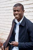 Portrait of happy black african man in urban environment
