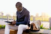 picture of bench  - African black business man hipster using tablet computer in park on break from work - JPG
