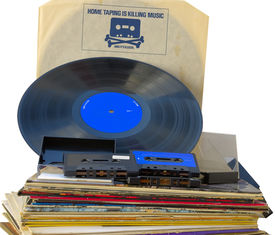 stock photo of skull crossbones  - Retro graphics vinyl record inner sleeve with 1980s anti copyright infringement campaign skull and crossbones with cassette tape head - JPG
