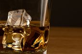 picture of whiskey  - close up shot of whiskey with ice cubes - JPG