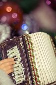 stock photo of accordion  - Christmas santa toy playing the accordion vintage photo effect background - JPG