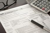 picture of income tax  - Individual Income Tax return form on desk - JPG
