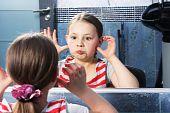 Girl Grimacing At Mirror