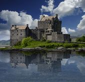 pic of chimney rock  - The Eilean Donan Castle in Scotland reflected in the water - JPG