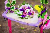 stock photo of swing  - wedding bouquet on a wooden swing swing hanging on a tree branch entwined with flowers