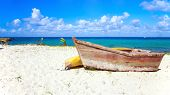 picture of caribbean  - Small wooden boat on caribbean beach in Dominican Republic - JPG