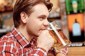 image of beer mug  - Tasting fresh brewed beer - JPG