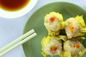 stock photo of siomai  - Shumai Chinese Steamed Pork Dumplings With Sauce On White Background - JPG