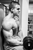 foto of dumbbell  - Strong and muscular guy with dumbbell - JPG