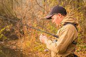 image of fisherman  - Fisherman on the river bank - JPG