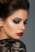 picture of arabic woman  - Beauty portrait of young beautiful brunette woman with arabic makeup looking down over her shoulder - JPG