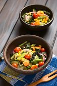 image of sweet-corn  - Two rustic bowls of baked vegetables  - JPG