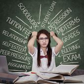 image of tied hair  - Teenage female student facing many problems and grabbing her hair ties in the class - JPG