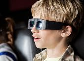 stock photo of watching movie  - Closeup of boy watching 3D movie in cinema theater - JPG